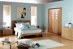 Madrid range of freestanding bedroom furniture, showing a wardrobe run of frosted pannelled doors in a recess and matching bedsides and drawer chest