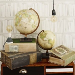 Globes and books in the style of historical explorers