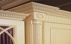 Ornate pilaster column show in our traditional Westminster range of fitted furniture