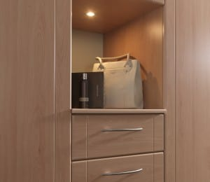 Sorrento fitted furniture range in beech finish, showing storage & lighting option